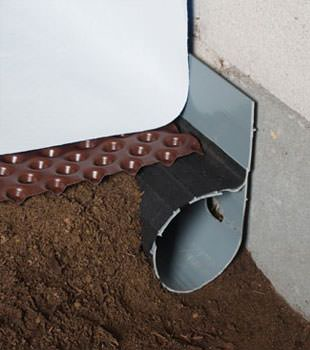 Closeup of a crawl space drainage system installed in Yadkinville