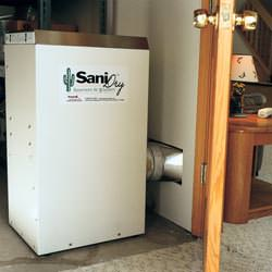A basement dehumidifier with an ENERGY STAR® rating ducting dry air into a finished area of the basement  in Wytheville